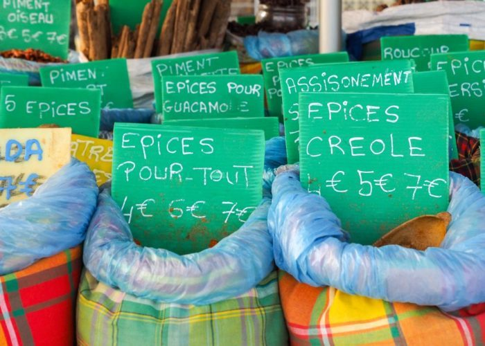 Assortment choice of spices, basket on market stall