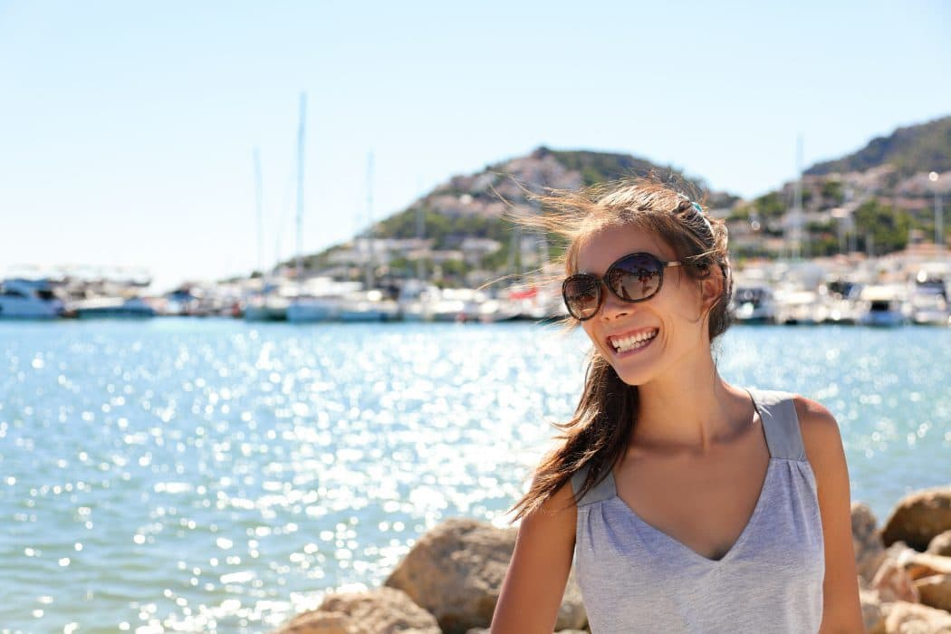 Leisure woman on holiday in yacht marina resort